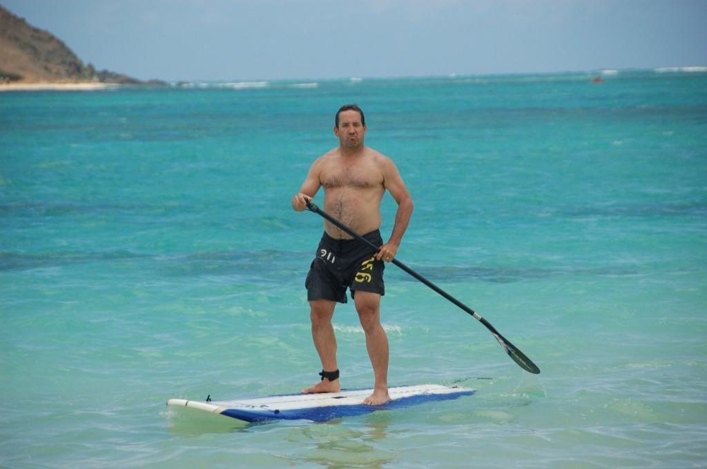 how to stand up paddle board riding the paddle board
