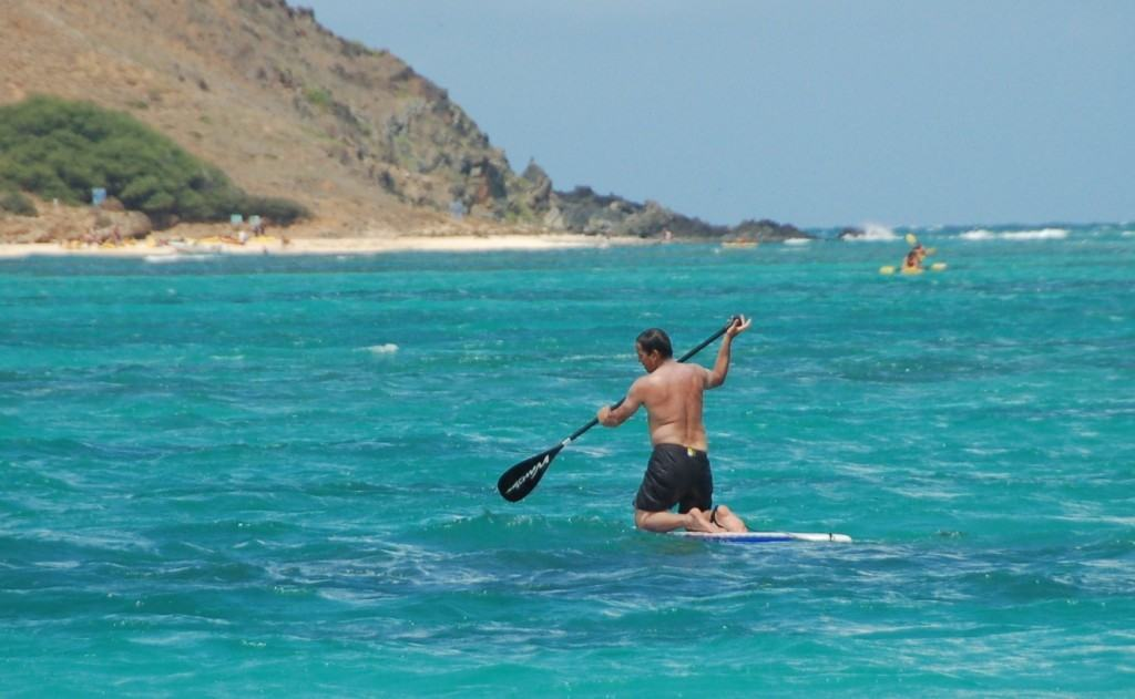 How to stand up paddle board kneeling while paddling out