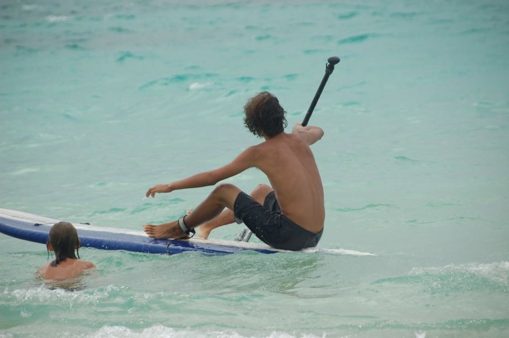 how to stand up paddle board getting up on the board