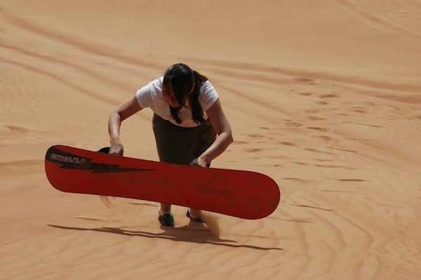 Dubai sandboarding Traveling Well For Less