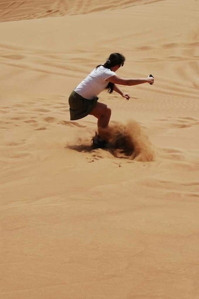 carving it up sandboarding in Dubai Traveling Well For Less