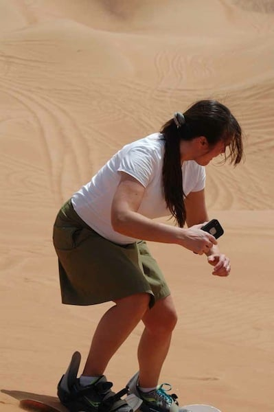 self filming while sandboarding in Dubai Traveling Well For Less