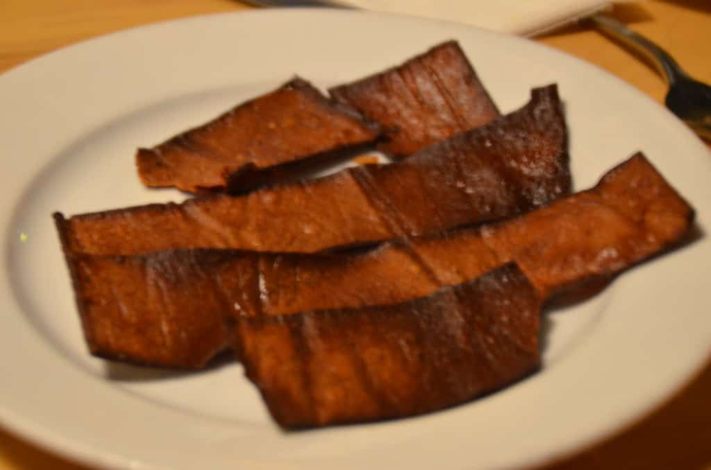 Vegan friendly bacon made from red lentils at Hugo's Restaurant. TravelingWellForLess.com