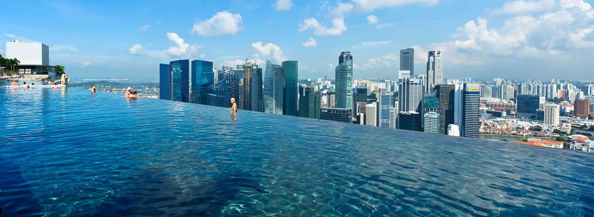 Marina Bay Sands Infinity Pool - the world's largest and highest infinity pool. TravelingWellForLess.com
