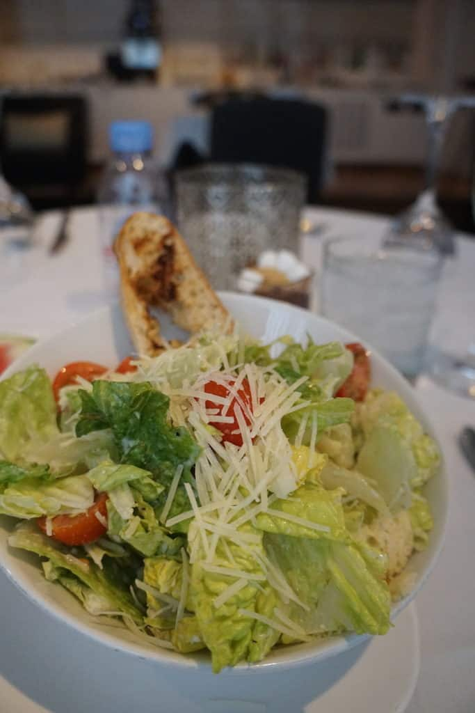 A Caesar salad with prawns (or without) is one of the items you can order from the First Class menu in the Star Alliance First Class Lounge at Los Angeles Airport. TravelingWellForLess.com