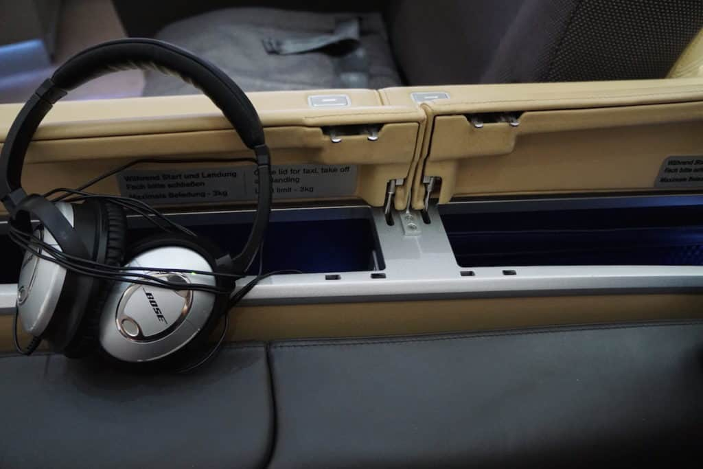 You can store your phone or tablet next to your seat. http://www.travelingwellforless.com