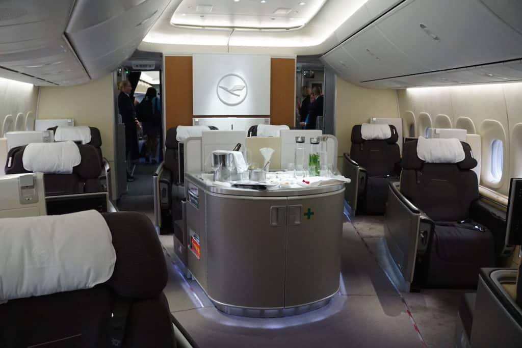 First Class on the Lufthansa 747-8 has 8 seats. http://www.travelingwellforless.com