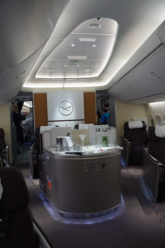 The First Class bar on Lufthansa 747-8 is in front of seats 3D and 3K. Learn how to score a First Class seat for $40. | travel hacking| Traveling Well For Less