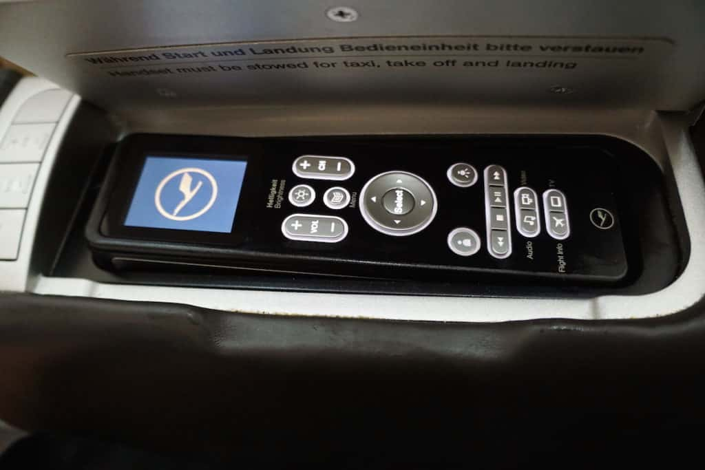 The remote is in the right armrest. http://www.travelingwellforless.com