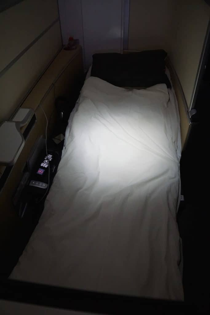 "Lufthansa First Class lie-flat seats convert to a 6' 5"" foot bed. Read more at http://www.travelingwellforless.com"