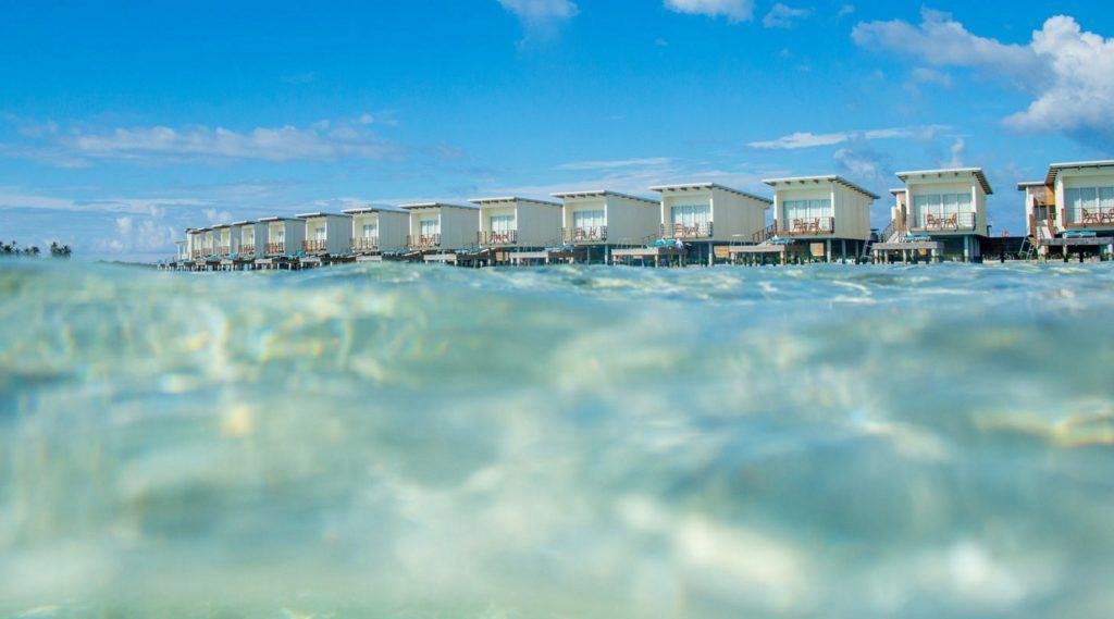 The Holiday Inn Resort Kandooma Maldives is the best value overwater villa in the Maldives. TravelingWellForLess.com
