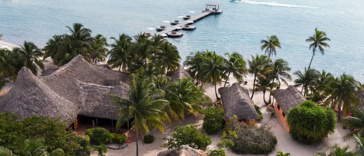 thatched villas on beach overlooking water, oceanfront resort and spa, Matachica resort and spa
