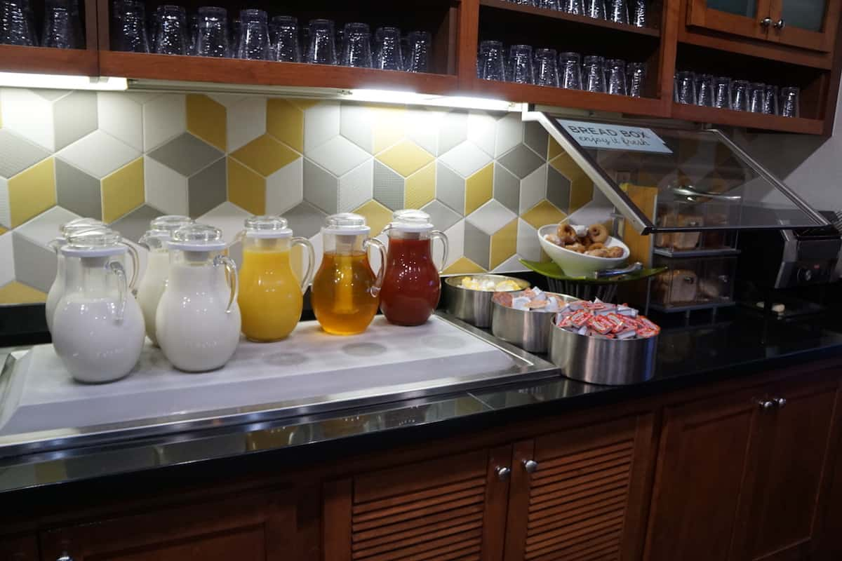 Milk and juice for breakfast at Hyatt Place Las Vegas. Traveling Well For Less | Hyatt Place Las Vegas review | The Hyatt Place Las Vegas is the best hotel because you get free breakfast, Wi-Fi, parking, airport shuttle, and more