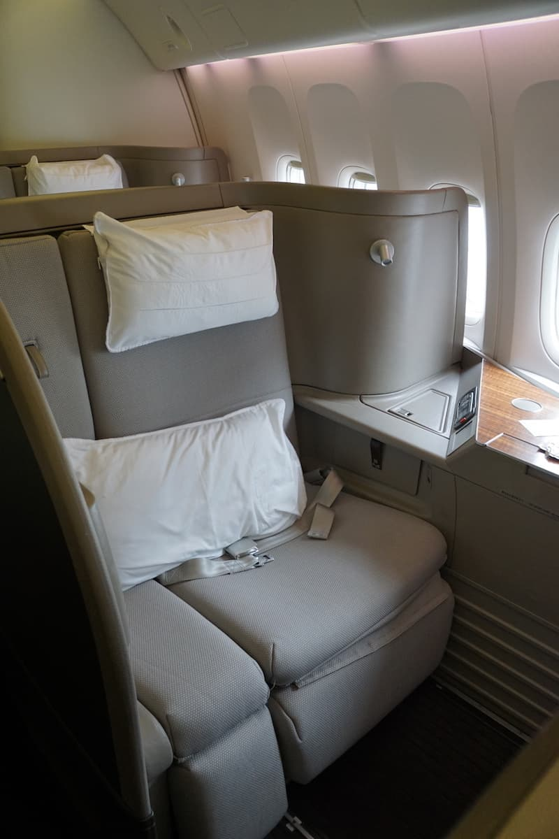 Get free airline tickets including First Class on Cathay Pacific by using travel rewards points. | How to travel for free | Traveling Well For Less |