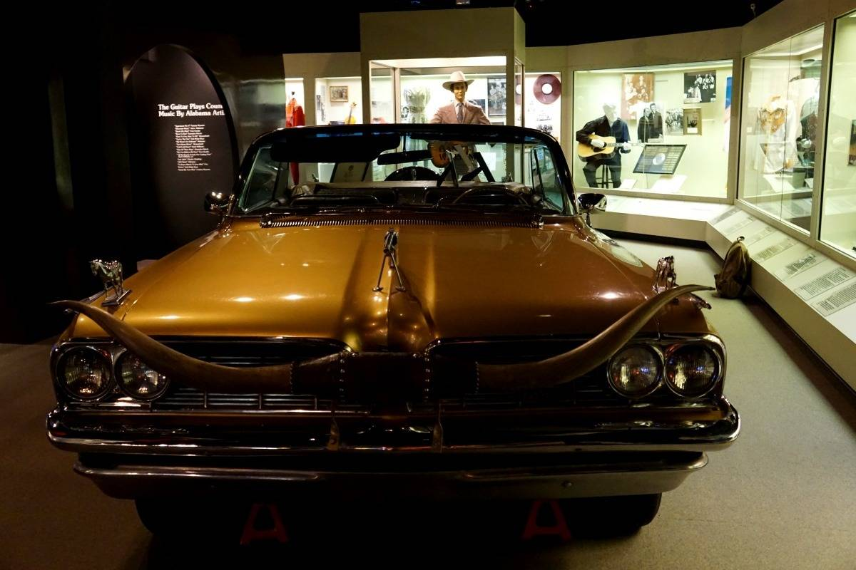 """""""Golden Country Car"""", a 1960 Pontiac convertible decorated with silver dollars and silver guns on exhibit at the Alabama Music Hall of Fame. 