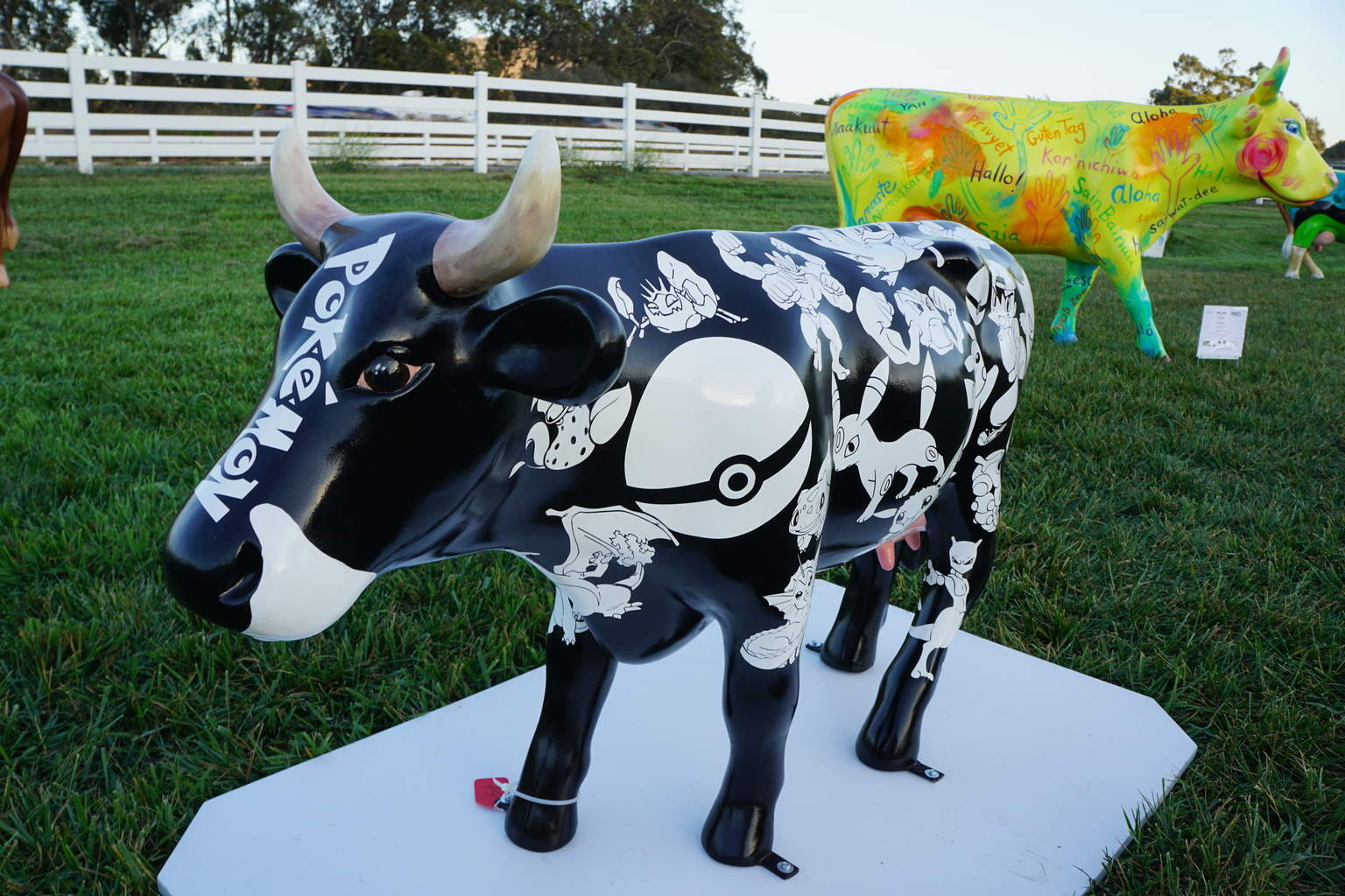 Poke-a-cow at CowParade SLO. Traveling Well For Less.com