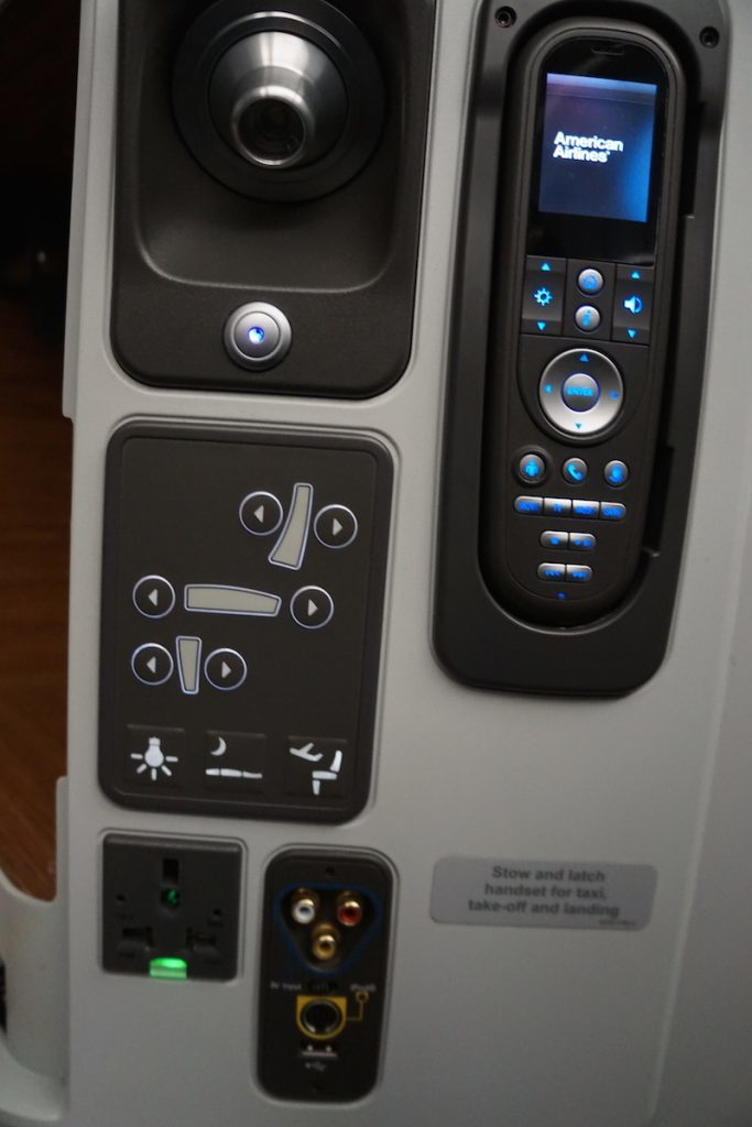 77W seat controls, inflight entertainmnt, and power ports. http://www.travelingwellforless.com