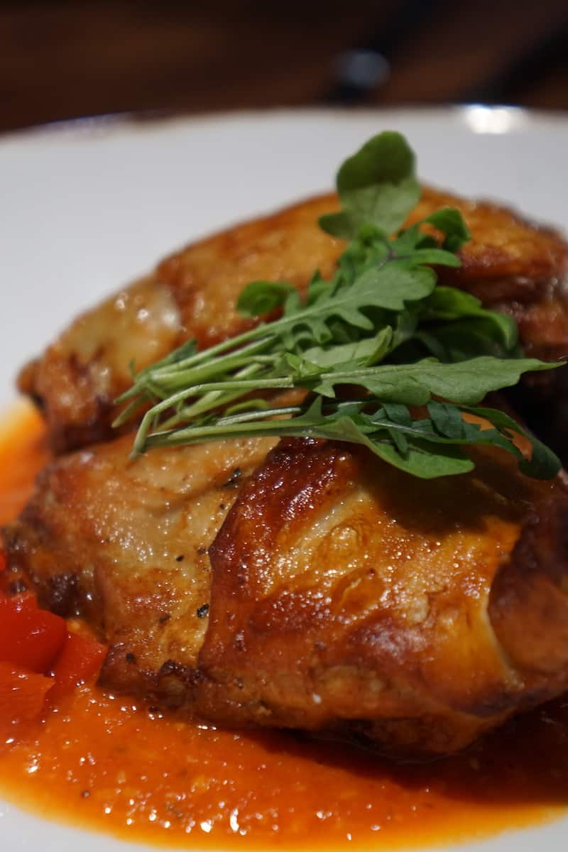 These bite-sized pieces of roasted chicken in romesco sauce with onions, piqullo peppers, and local squash is a nice choice if you want mean but don't want to order the steak or pork. | Dublin, Ohio | Columbus | Spanish food | where to eat in Columbus | TravelingWellForLess.com