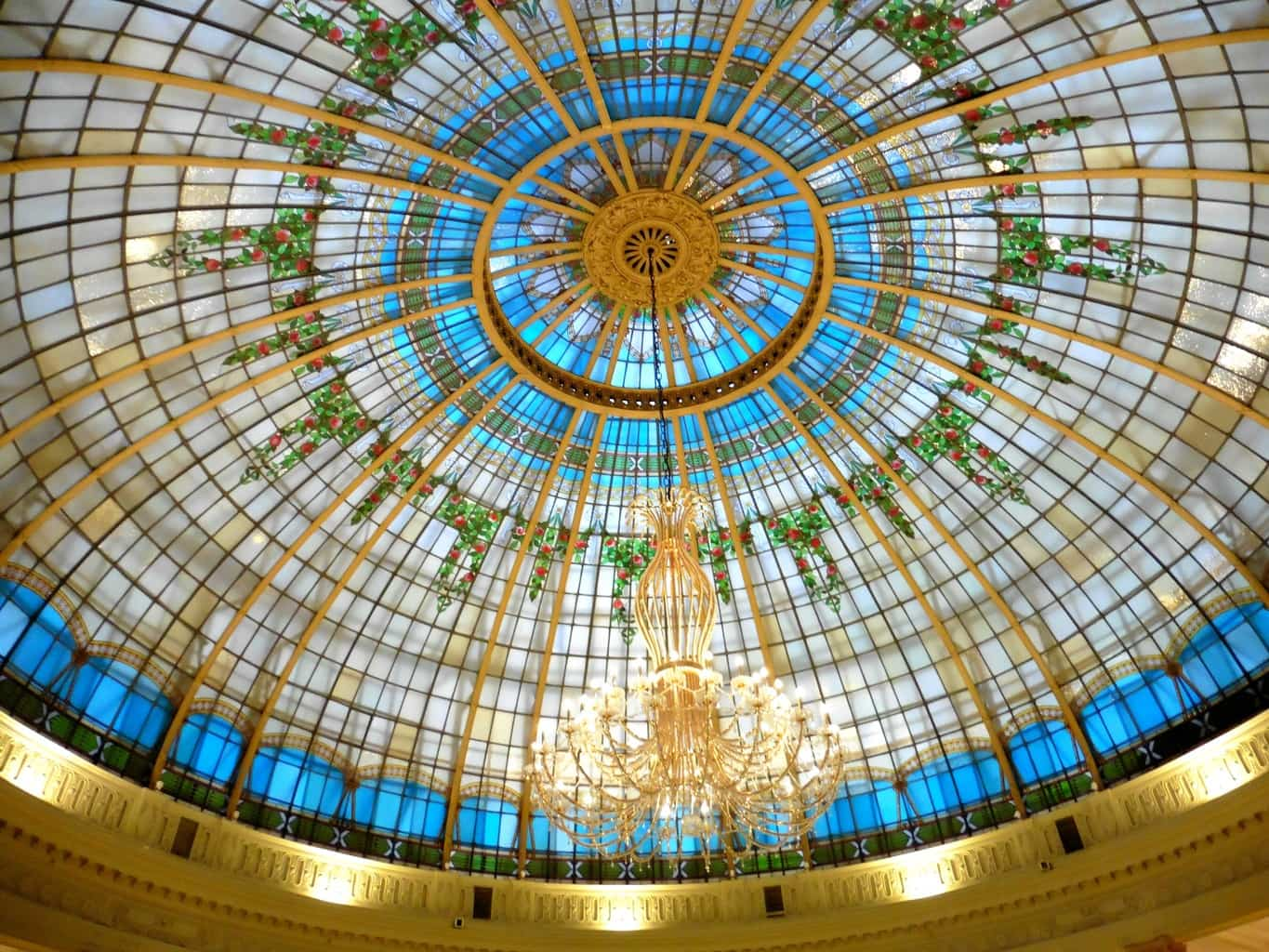The stained glass domed ceiling of La Rotonda Westin Palace Madrid is worth seeing. TravelingWellForLess.com