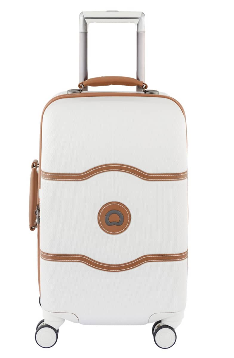 The Delsey Chatelet Hard + carryon just speaks to me. It's elegant, chic, stylish, and functional. The spinner wheels made it easy to pull through the airport. Thanks to the brake system, you don't have to worry about it running away.   travel gifts for Mother's Day   https://www.travelingwellforless.com #travelgifts #mothersdaygifts
