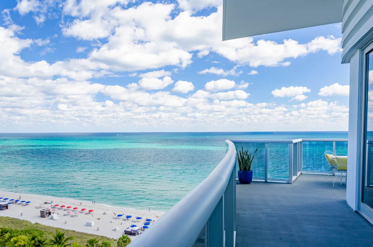 View of Atlantic Ocean from suite at Confidante Miami hotel. Want free upgrades and other perks? Read our ultimate guide on how to get VIP treatment at hotels. https://www.travelingwellforless.com