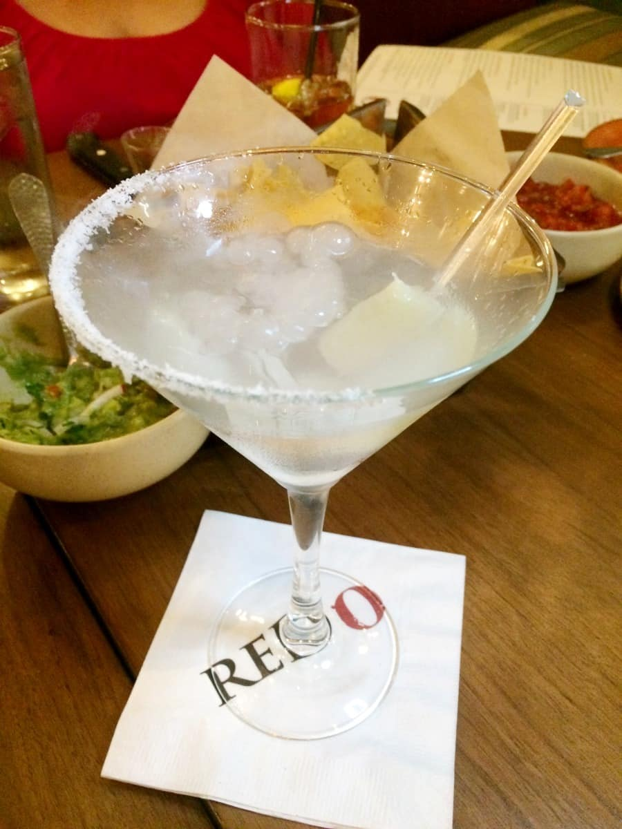 Dry ice creates the bubbling effect on the martini inspired Casa Blanca Margarita. | Rick Bayless | Red O | Where to eat in San Diego | Mexican restaurant | TravelingWellForLess.com