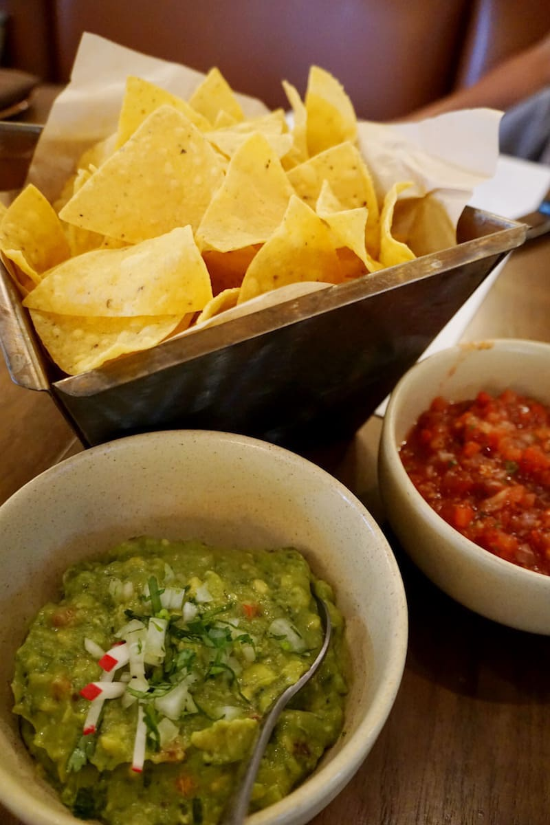 The Classic Guacamole at Red O beckons you with creamy chunks of soft ripe avocados and hints of tomatoes and onions. Almost daring you not to break your tortilla chip as you dip into its deliciousness. | Rick Bayless | Where to eat in San Diego | Mexican restaurants | TravelingWellForLess.com