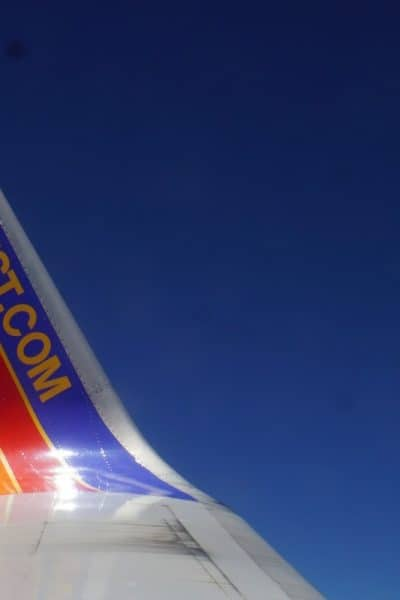 Tail of Southwest Airplane. Get a free Southwest Status match.