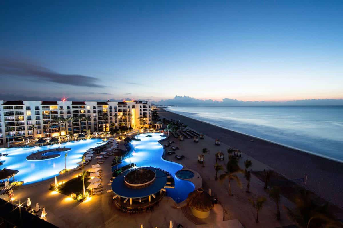 beachfront hotel at sunset