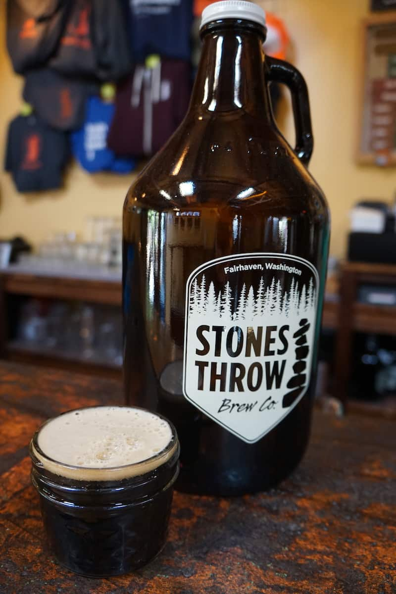 Constructed out of shipping containers and built on the site of a former brothel, Stones Throw Brewing has an outdoor area, deck, and a bar with refrigerated pint holders. #craftbeer #beer #brewery #Bellingham #Washington