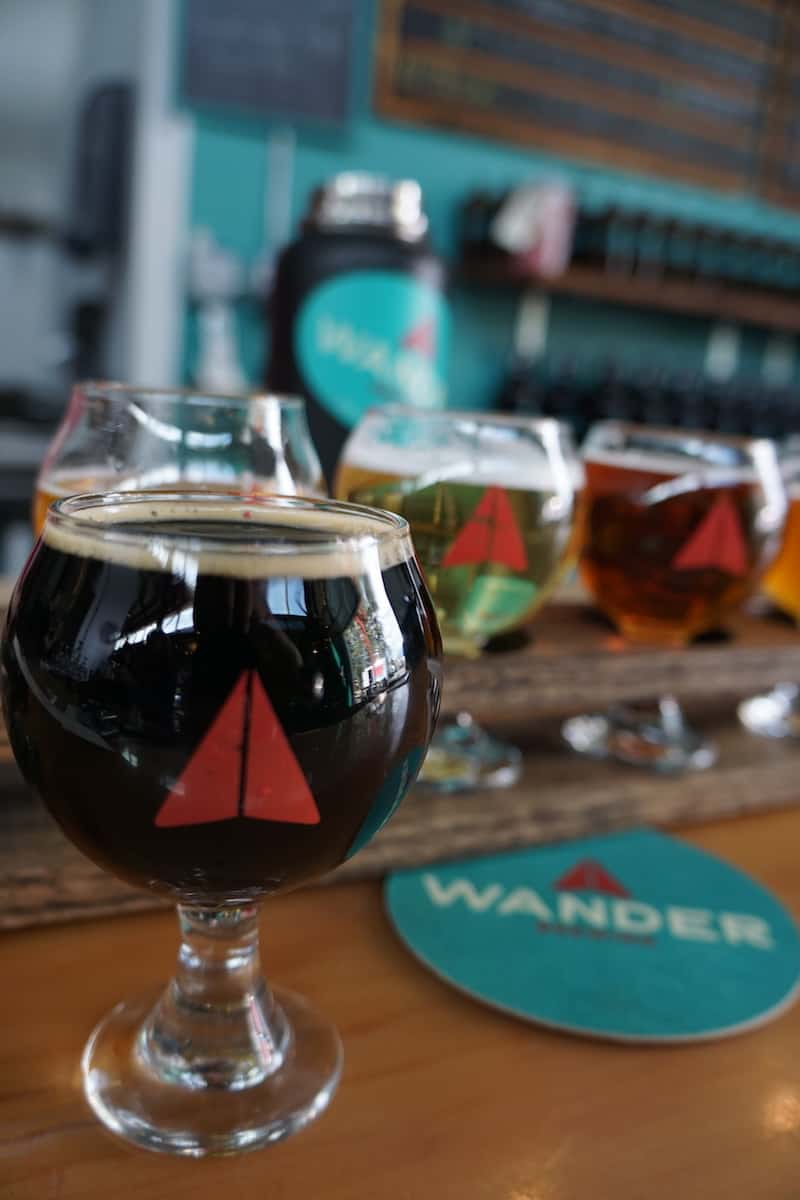 Award-winning Wander Brewing is a local and visitor favorite. Travelers will love Wander Brewing's paper airplane logo. #craftbeer #beer #brewery #Bellingham #Washington
