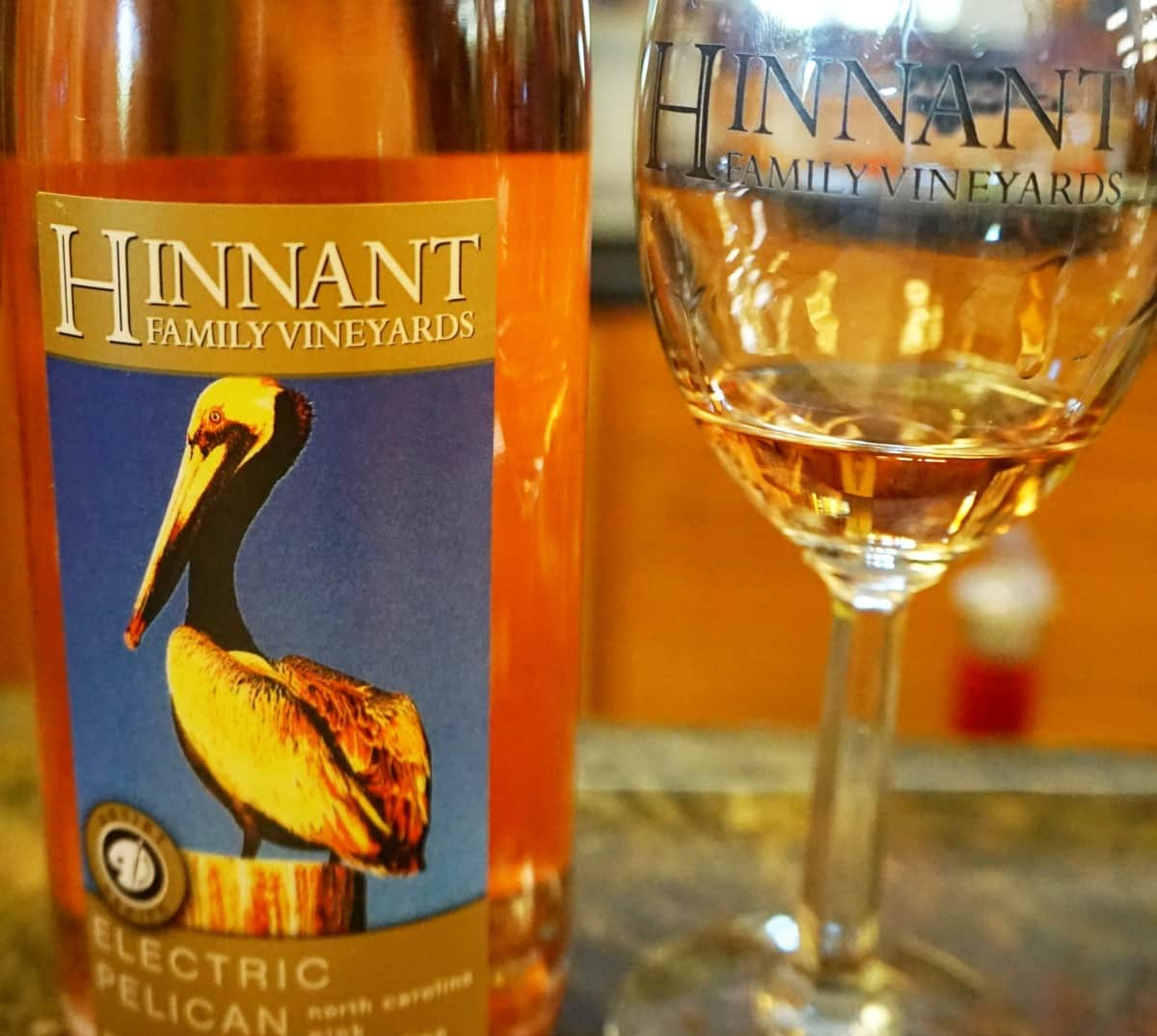 Made from American grapes, muscadine wine is a sweet wine, almost like a dessert wine. And while the fruit is already sweet many of the winemakers add sugar. Muscadine wines pairs with beef, lamb, and seafood.| wine | Hinnant Vineyards | Things to do in Johnston County, North Carolina | TravelingWellForLess.com