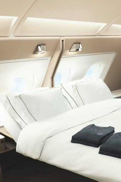 Imagine if you had unlimited miles and points. Would you sip champagne while lounging on your bed in First Class. Here's how to earn unlimited miles and points.