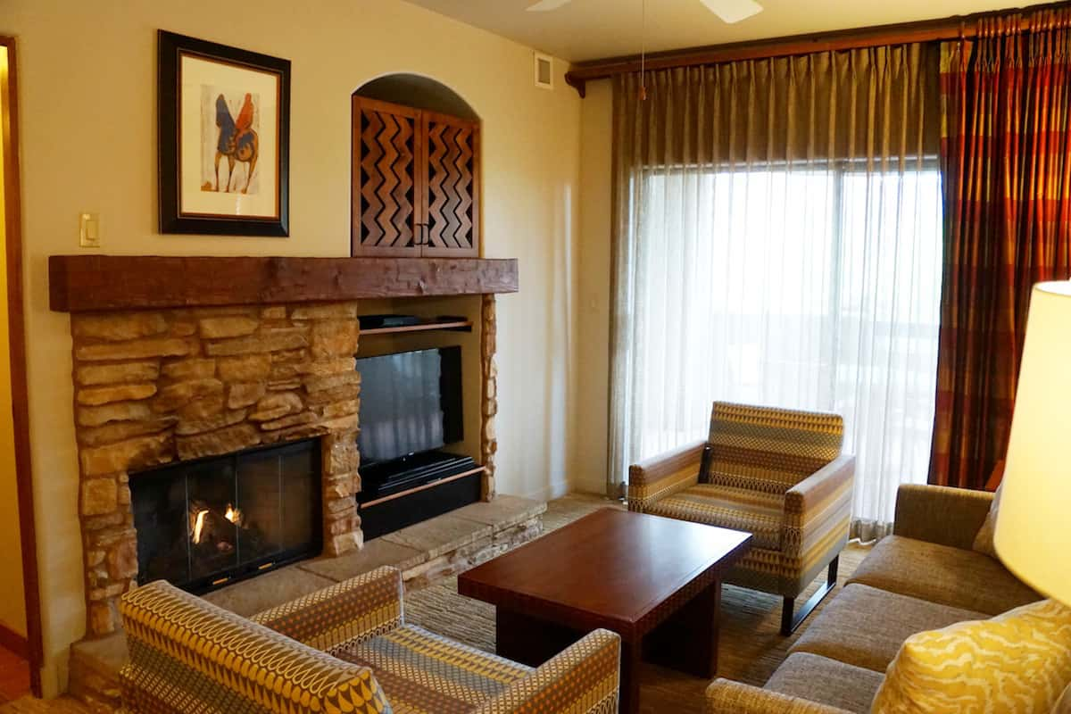 You can relax in front of the fireplace while watching TV or a movie in the cozy living room. The couch and two chairs can seat five.