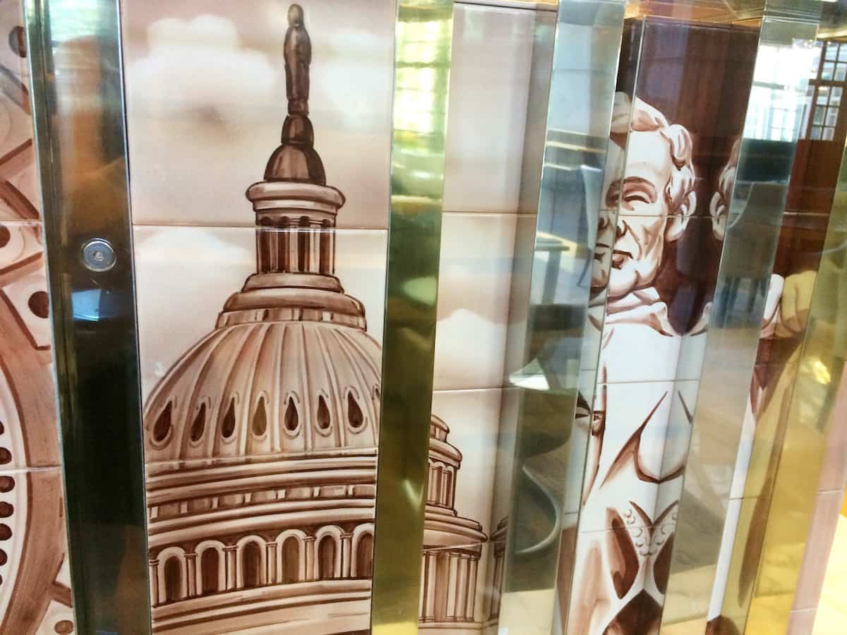 Before you rush to check-in, take a moment to stop and look at the glass topped table. The base features white tiles of past presidents, notable Washington, DC landmarks. | Fairmont Washington DC | Fairmont Gold | luxury hotel | where to stay in Washington DC | TravelingWellForLess.com
