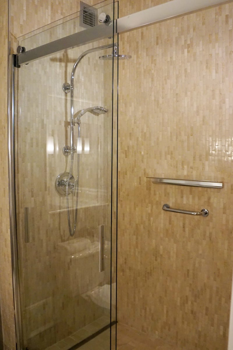 Large walk-in showers include a fixed shower head and an adjustable hand-held shower head. Water temperature and pressure were perfect. | Fairmont Washington DC | Fairmont Gold | luxury hotel | where to stay in Washington DC | TravelingWellForLess.com