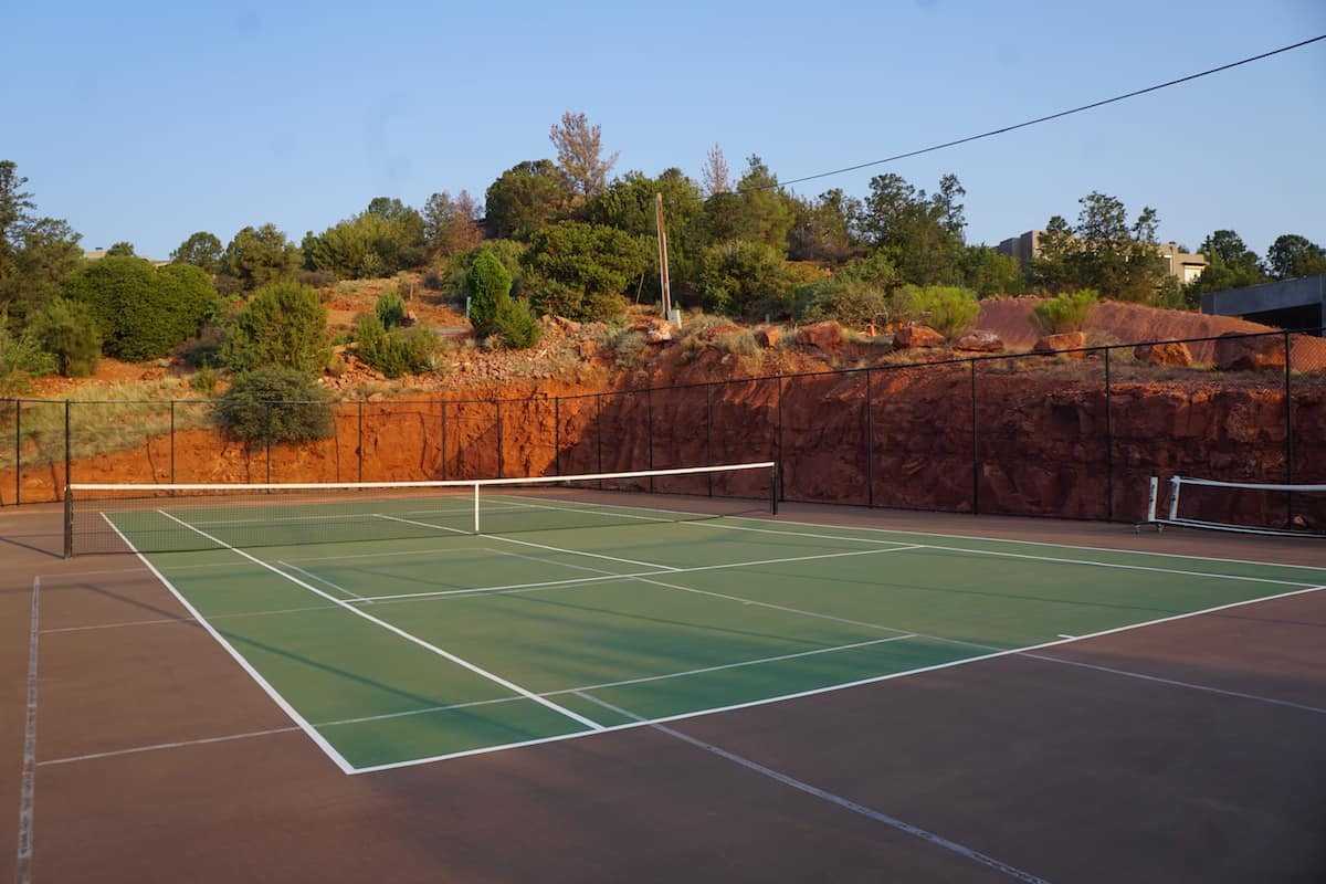 Keep your backhand in check by playing a few sets on the tennis court.