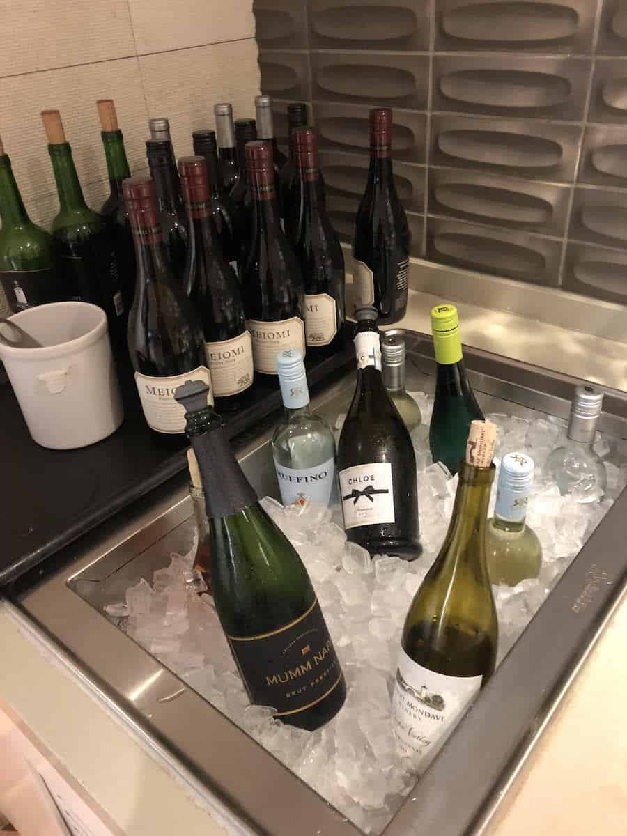 Serve yourself wine and champagne from the buffet station at the Star Alliance Business Class Lounge LAX