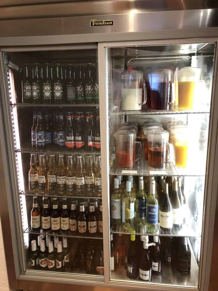 Beer, wine, and juices in self-serve fridge Star Alliance Business Class lounge LAX