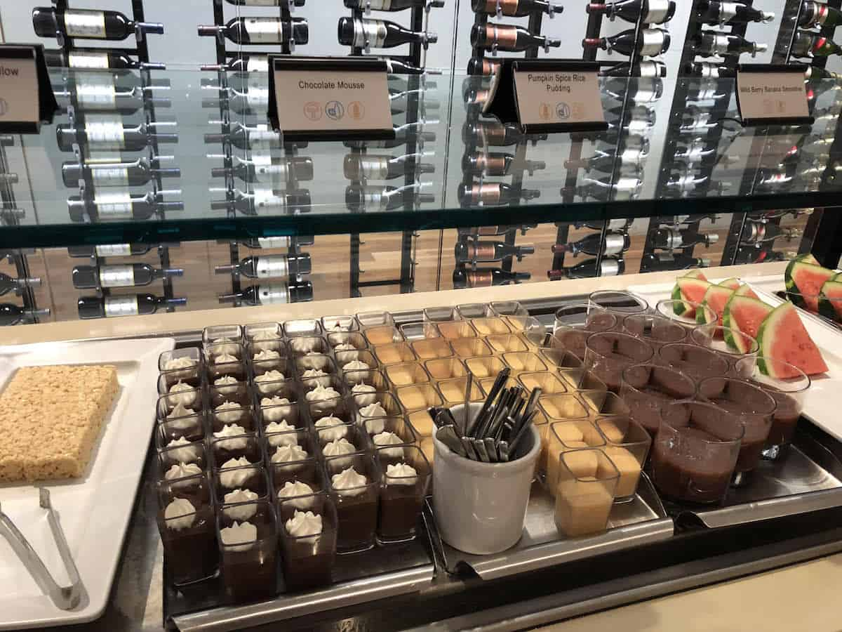 rice krispy treats, chocolate mousse, pumpkin spice pudding, smoothies, watermelon in the dessert buffet at Star Alliance Business Class Lounge LAX