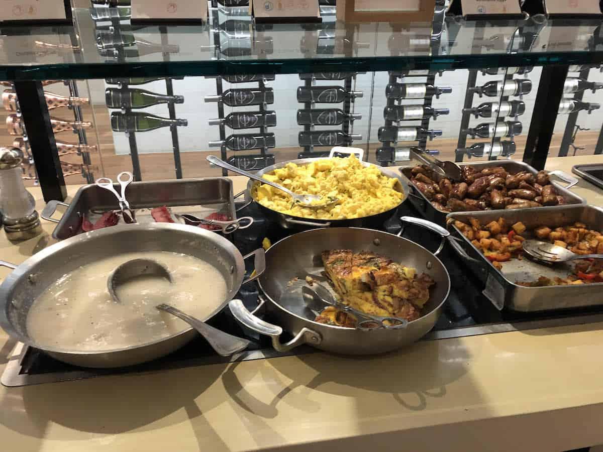 Eggs, quiche, sausage, potatoes, gravy Star Alliance Business Class Lounge LAX morning buffet