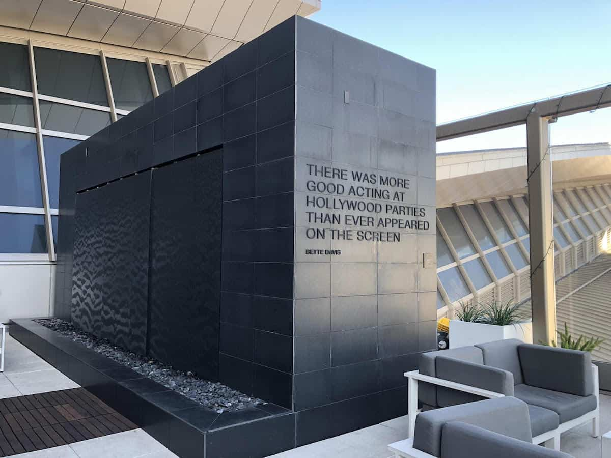 Quote from Bette Davis on water wall at the Star Alliance Business Class Lounge LAX outside terrace