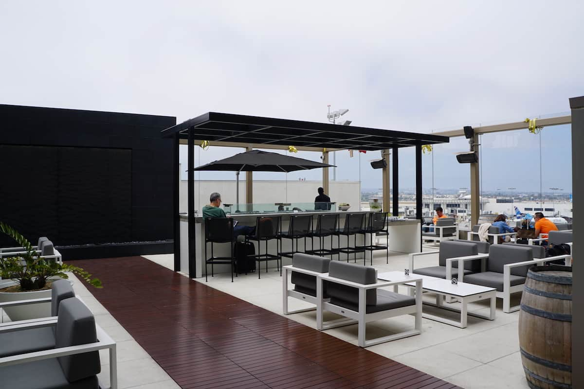 runway view outdoor seating Star Alliance Business Class Lounge LAX