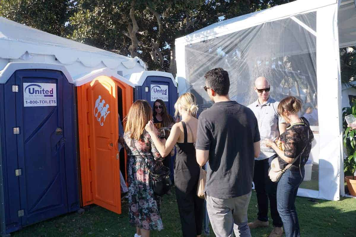 The long line for the orange porta-potty, it's not what you think. Behind that orange door is the Monkey Shoulder Speakeasy. | San Diego Bay Wine and Food Festival | SommCon | Vault | wine | TravelingWellForLess.com