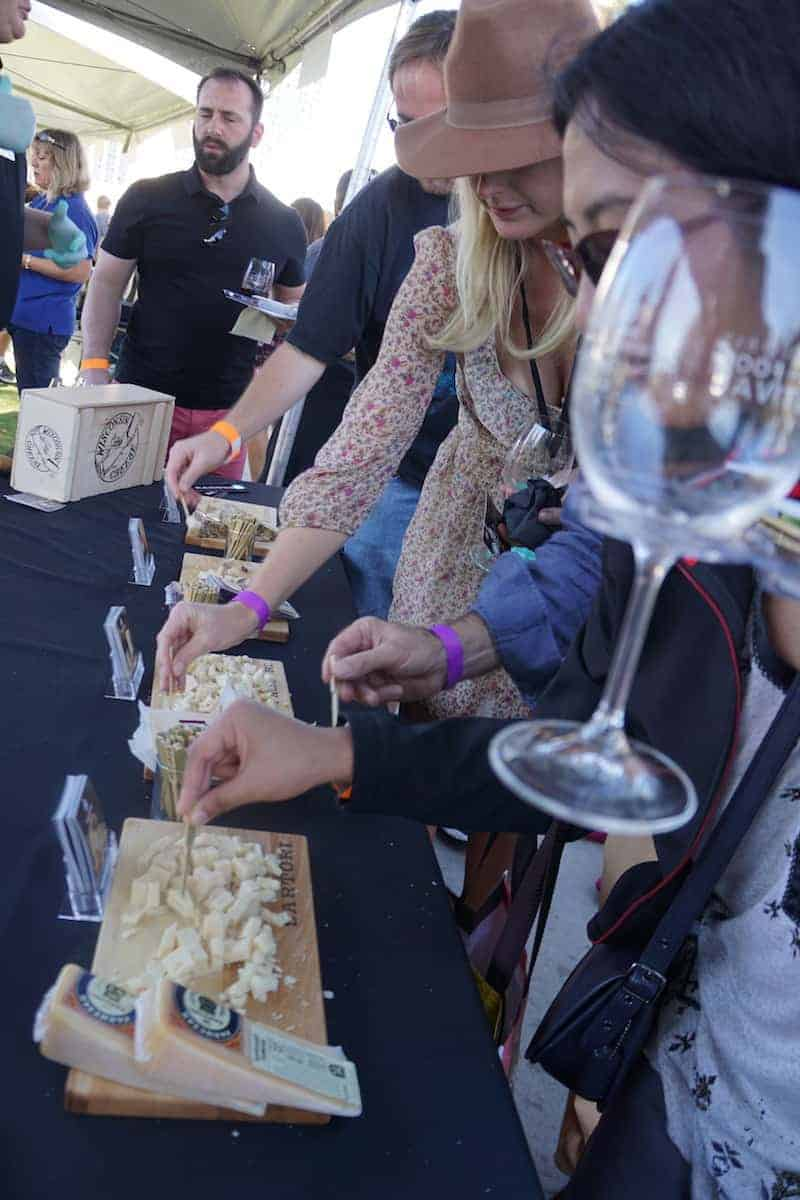What's a wine tasting without a little cheese? Sartori brought their Montamore, Sarvecchio Parmesan, Merlot Bellavitano, and Black Pepper Bellavitano cheeses. | San Diego Bay Wine and Food Festival | things to do in San Diego | wine | TravelingWellForLess.com