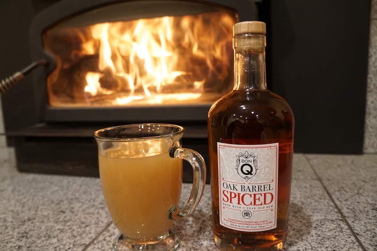 Spiced apple cider with Don Q Oak Barrel Spiced rum is a great way to warm up after a hike or on a chilly day.   TravelingWellForLess.com