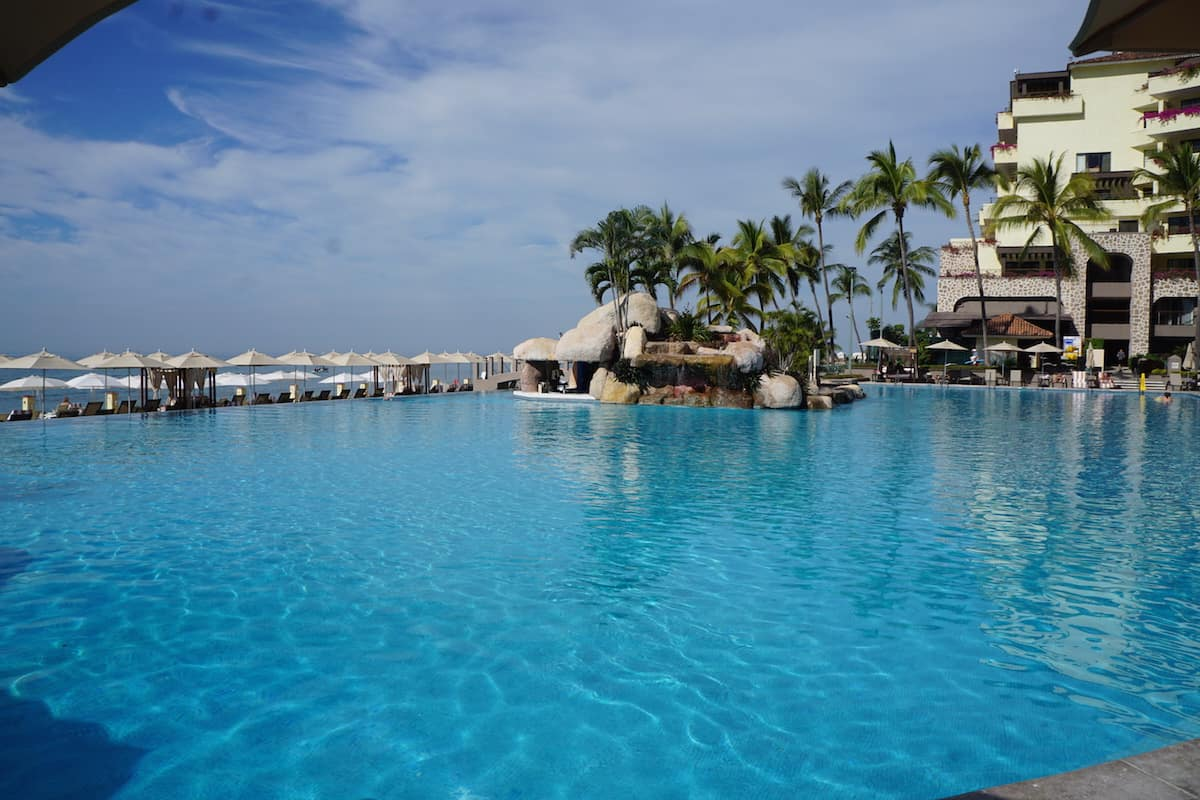 Take a dip in the infinity pool while enjoying stunning views of Banderas Bay. The swim-up bar and pool attendants will ensure that you stay hydrated. | Marriott Puerto Vallarta Resort & Spa | where to stay in Puerto Vallarta | www.TravelingWellForLess.com