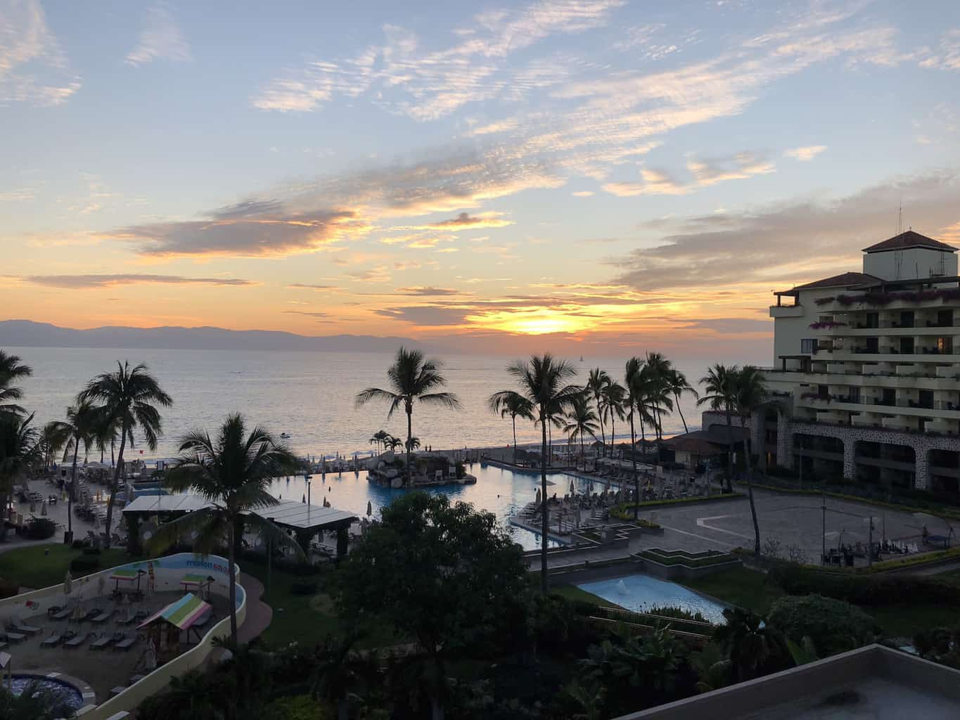 Imagine lounging on your private balcony, taking in the view of the ocean while enjoying the sunset. | Marriott Puerto Vallarta Resort & Spa | where to stay in Puerto Vallarta | www.TravelingWellForLess.com