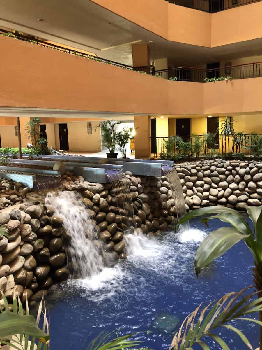 Doors in other tower face an atrium with a waterfall. | Marriott Puerto Vallarta Resort & Spa | where to stay in Puerto Vallarta | www.TravelingWellForLess.com