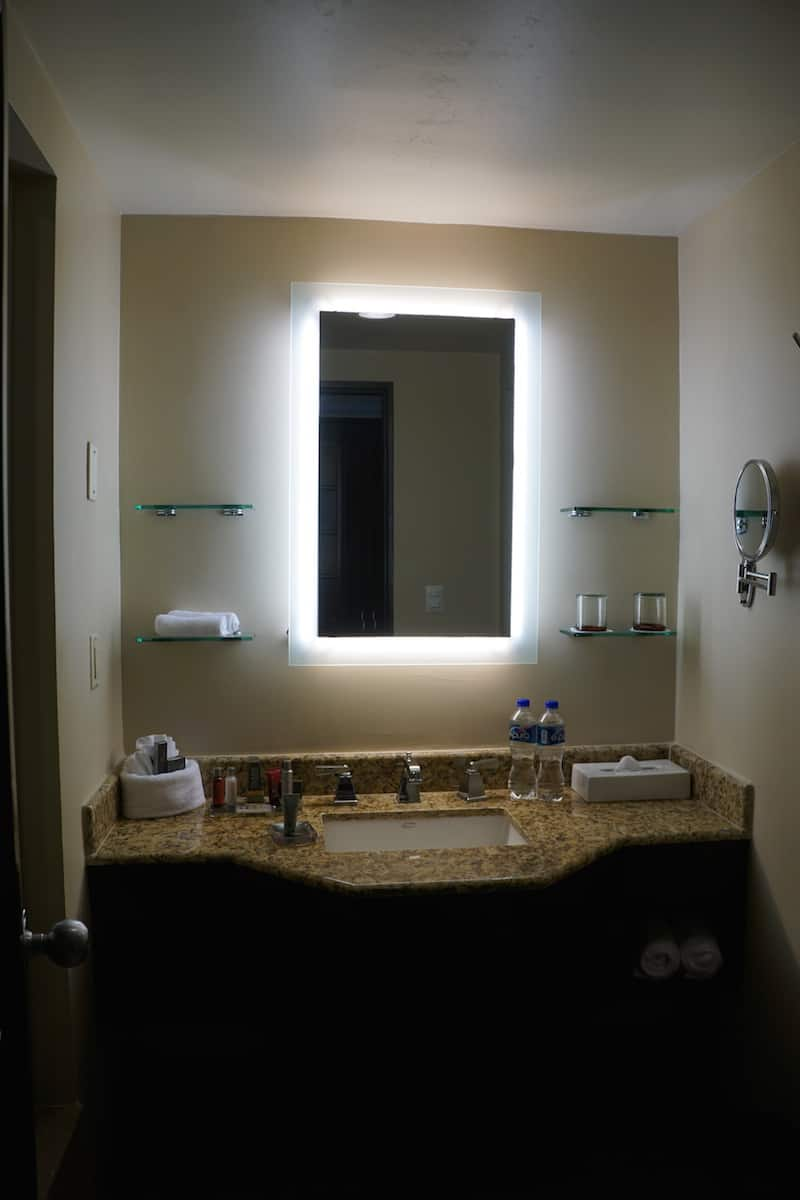 The sink is in the middle. The anti-fog mirror means your hot shower won't steam up the mirror. | Marriott Puerto Vallarta Resort & Spa | where to stay in Puerto Vallarta | www.TravelingWellForLess.com